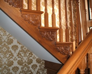 Staircase in oak, carved scroll detail